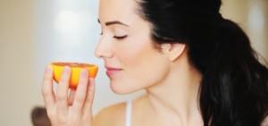 woman_smelling_orange_425x200